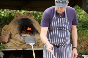 Cooking pizzas on the Frog Oven during May Fair