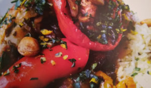 Chicken Basquaise with slow-roasted tomatoes, orange gremolata and saffron rice
