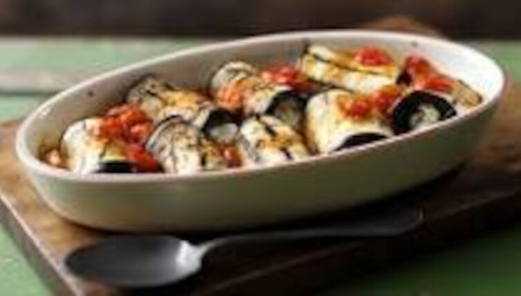 Aubergines filled with artichokes, mushrooms and pine nuts in a tomato sauce